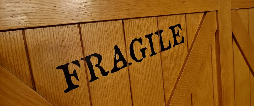 """Fragile"" is even written on the room's fold-out bed to make the amenities resemble shipping crates."