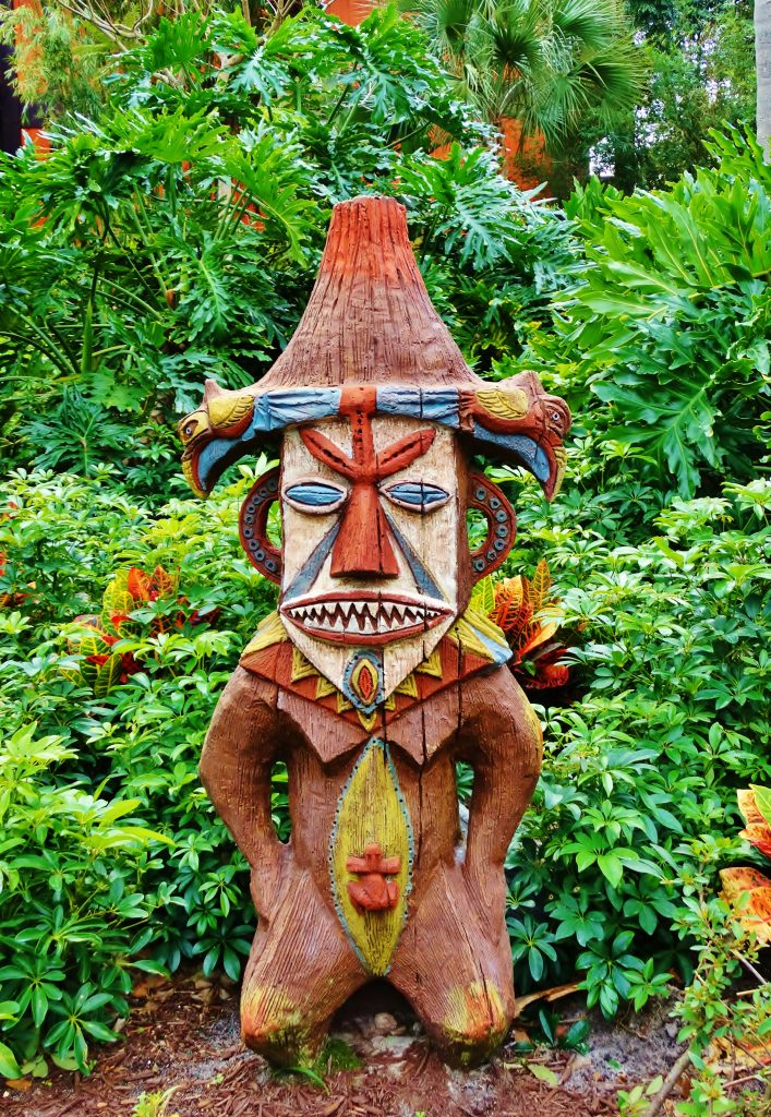 Wooden tiki located in the foliage at Disney's Polynesian Village Resort.